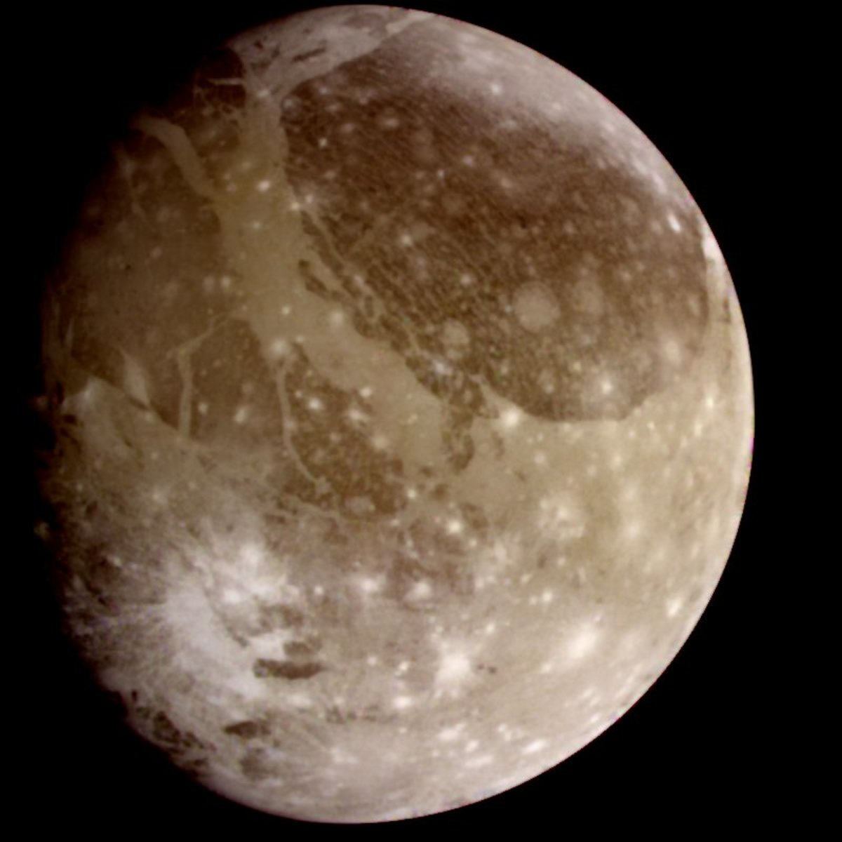 Ganymede, the largest moon in the solar system. The dark areas are older, more heavily cratered regions whereas the lighter areas are younger.