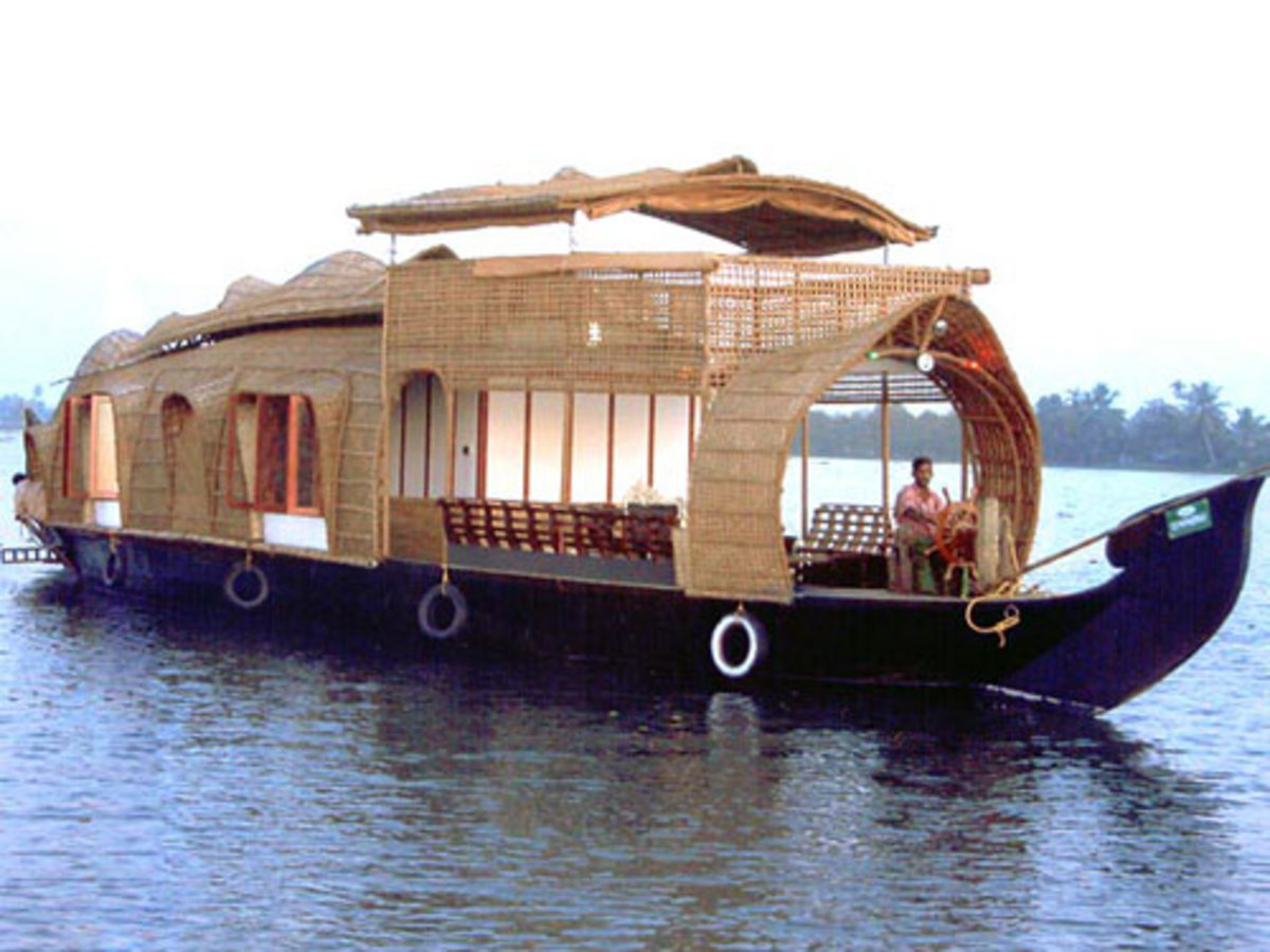 Then there are houseboats that take on all manner of forms around the world. Many of these are made by the person living in them. In this case, this is a small floating hotel in India catering to tourism.