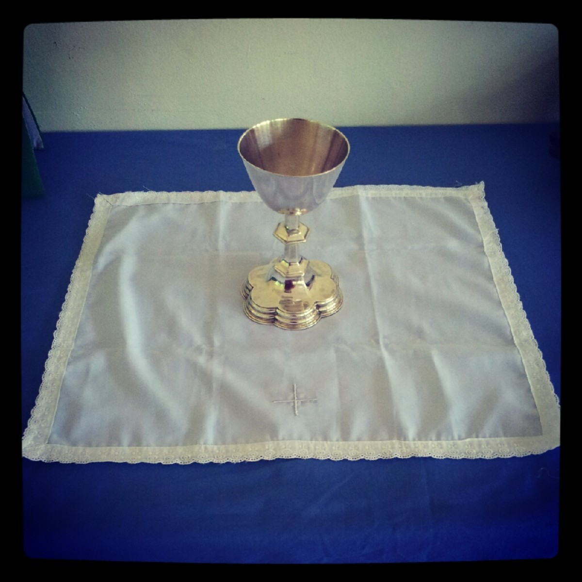 Step 2: Place the Celebrant's Chalice in the centre of the Corporal. If there is a Cross, the Cross should face the Celebrant