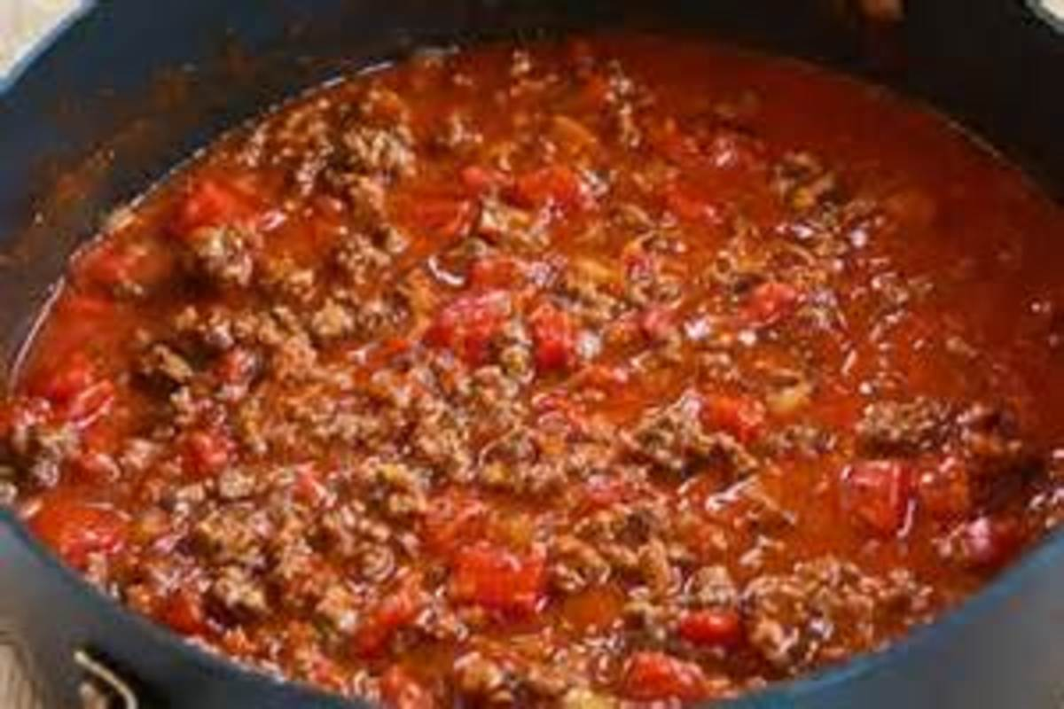 Add tomato paste and then diced tomatoes