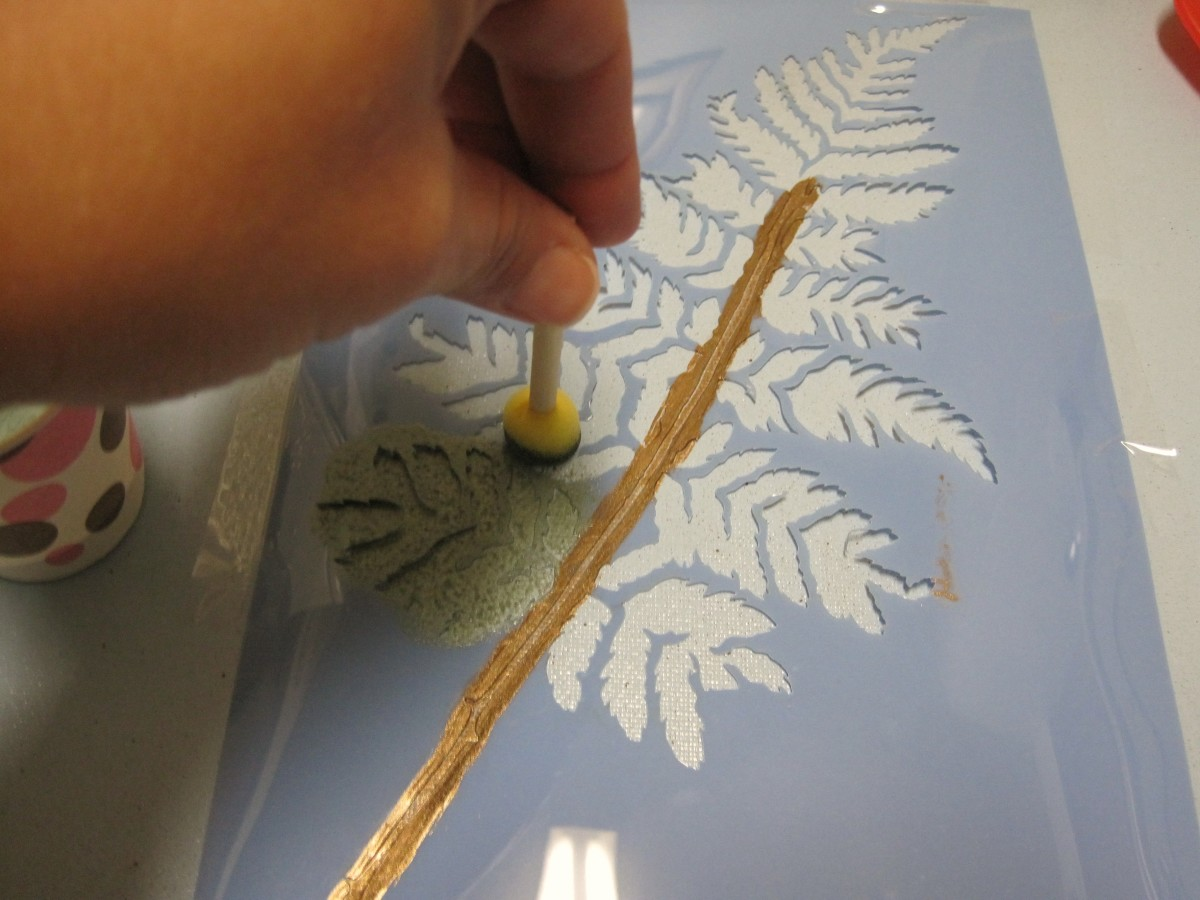 Paint the greenery with a flat stencil brush.