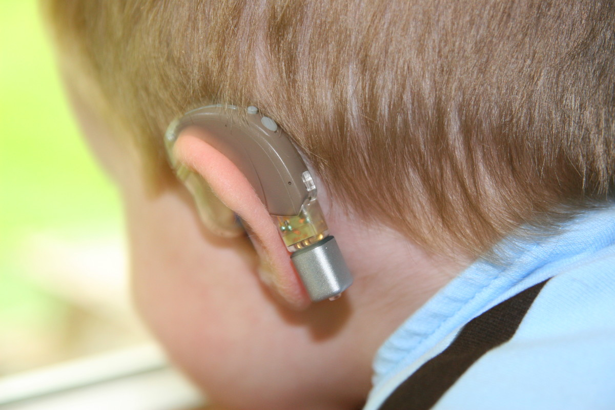 Personal FM receivers clip onto special boots that fit into the bottom of a hearing aid. The speaker's voice is transmitted directly to the hearing aids, reducing the problem of background noise.