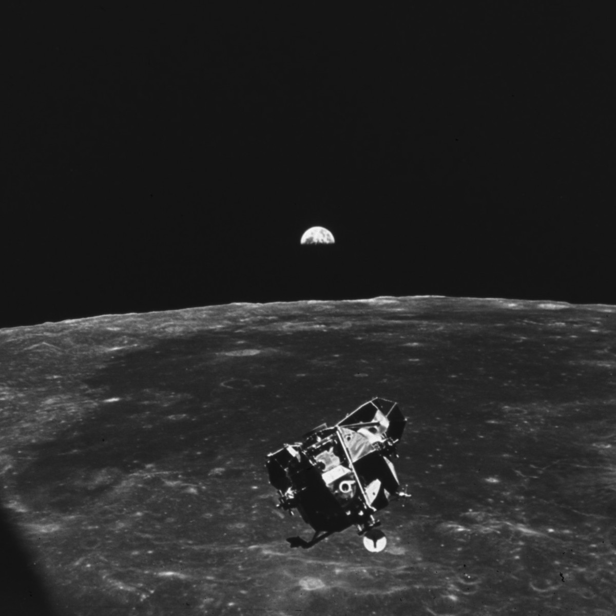 This photo shows the Lunar Module descending toward the surface of the moon after disengaging from the Command Module.