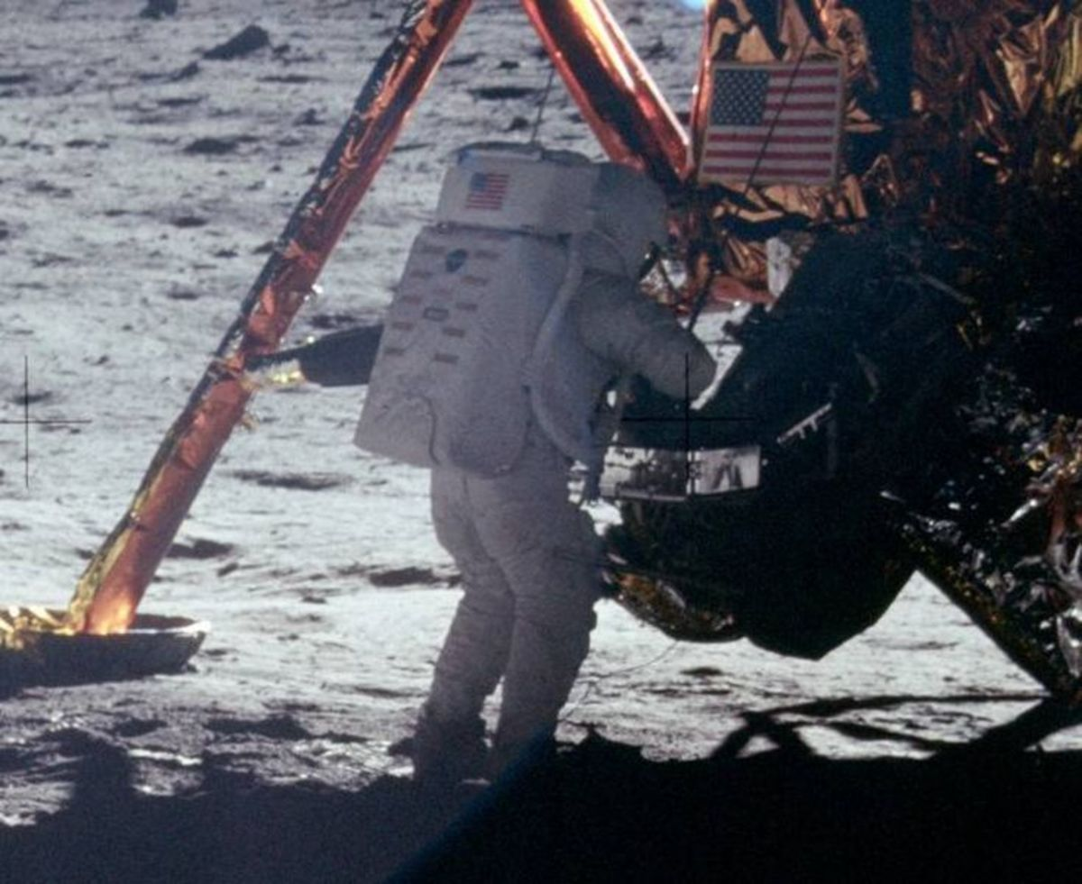 Neil Armstrong works at the LM in the only photo taken of him on the moon from the surface.