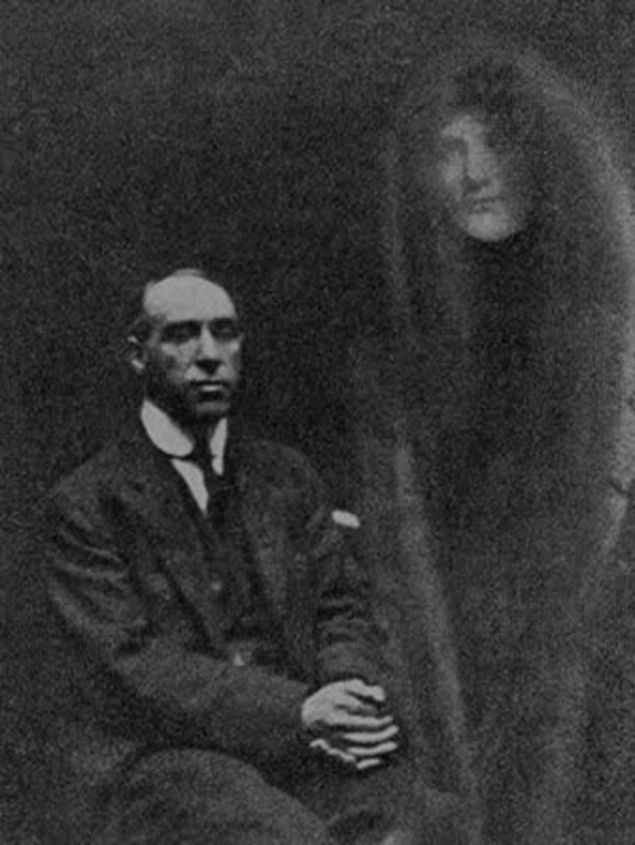 "One of William Hope's faked ""Spiritual Photos"". He was discovered when one of the spectral visitors was recognized as someone who was alive and well."