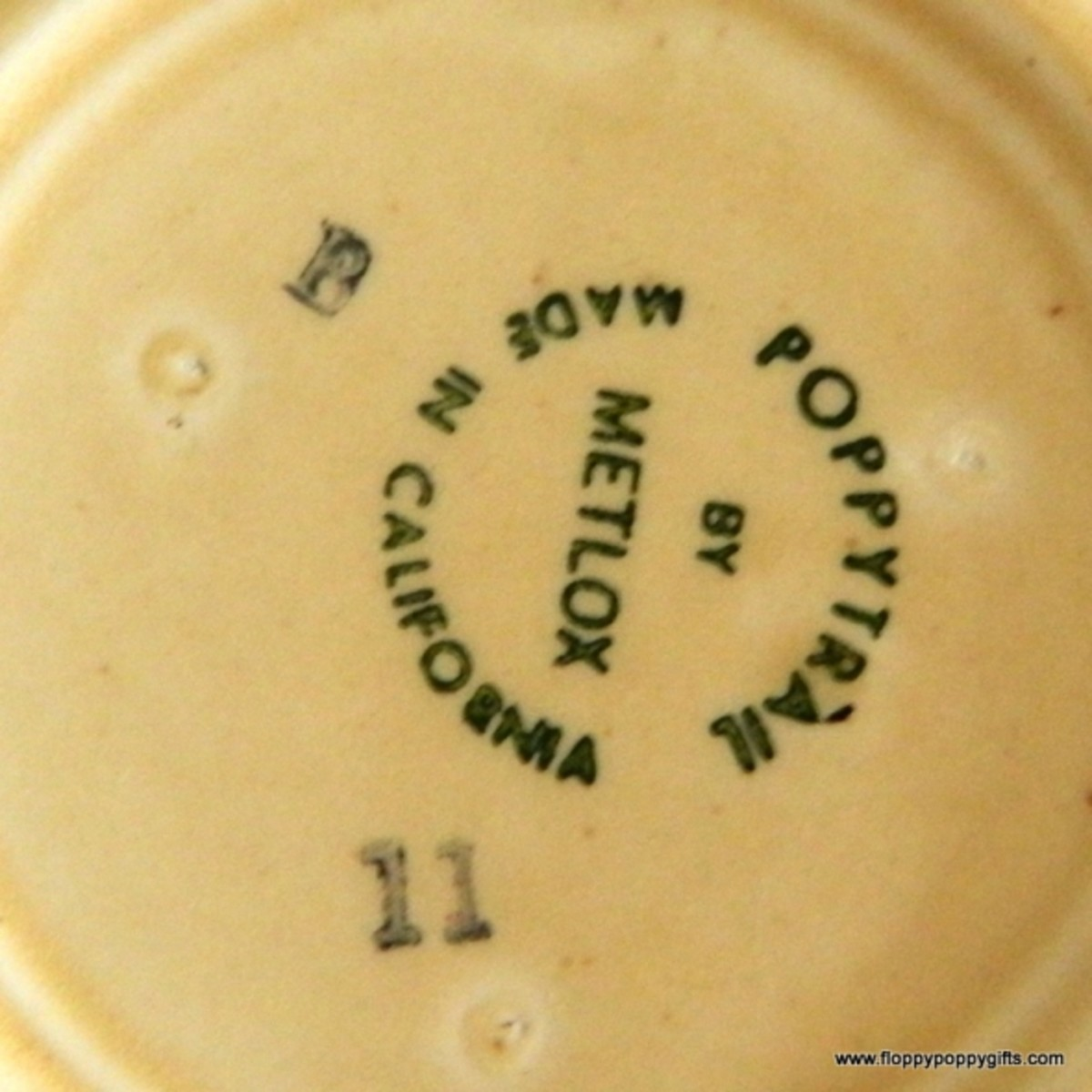 Another stamp on the underside of the creamer.
