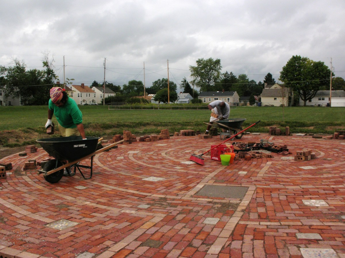This dedicated group is building a labyrinth on the school grounds.