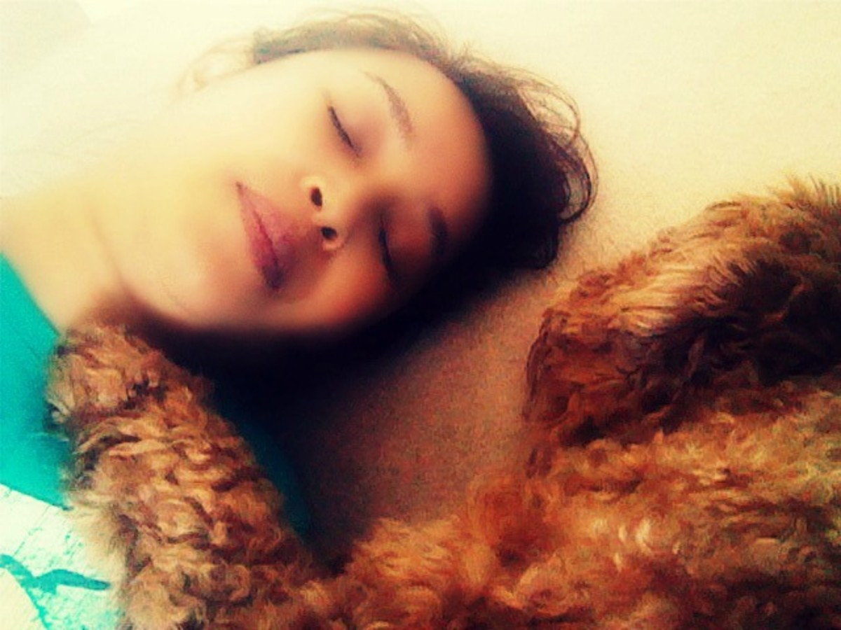 Lying on the carpeted floor with my dog, Simba.