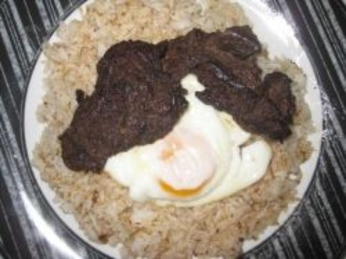 Tapsilog (thin cuts of fried beef, fried egg sunny side up and fried rice)