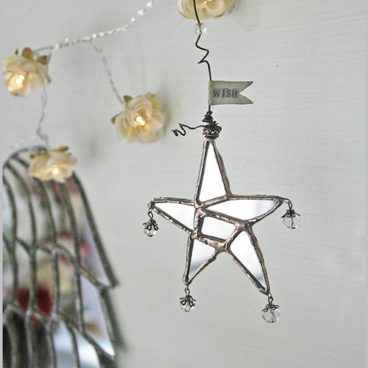 There are so many ways that you can use random pieces of wire for mixed media home decor.