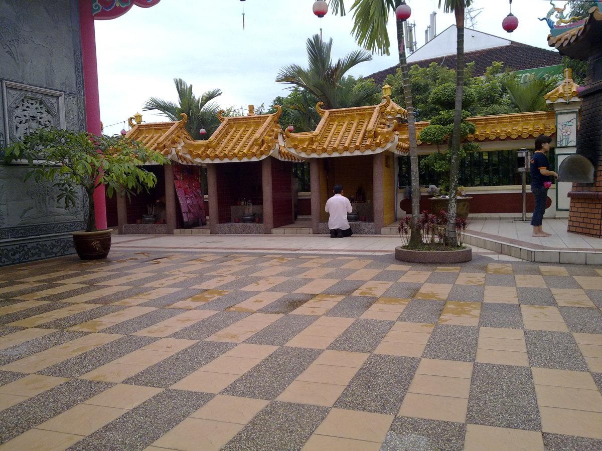 a devotee knelt down to pray the other deities
