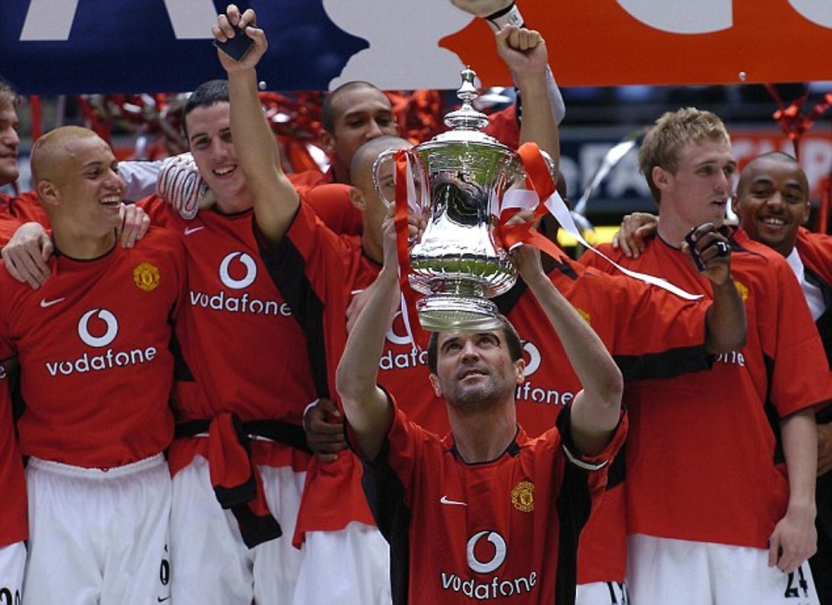 Manchester United's Roy Keane holding their 11th FA Cup