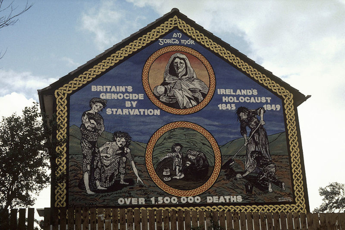 "Ireland's Holocaust mural on the Ballymurphy Road, Belfast. ""An Gorta Mór, Britain's Genocide by Starvation, Ireland's Holocaust 1845–1849."""