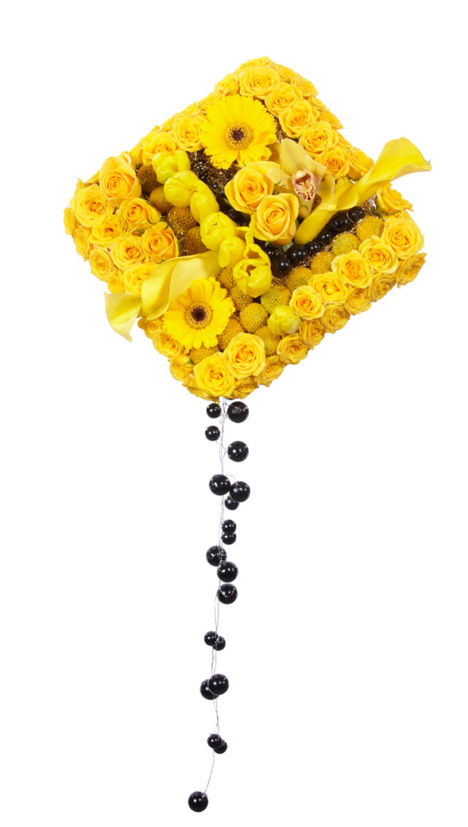 Unusual square bouquet with trails of beaded wire. This is a european style bouquet holder, all the flower stems have been cut short and the flowers placed in, flush with the foam.