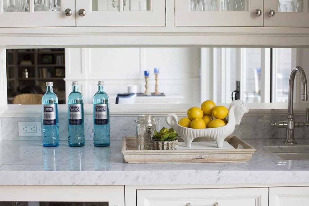 Your local glass company will be able to measure, cut and install mirror for a kitchen backsplash.