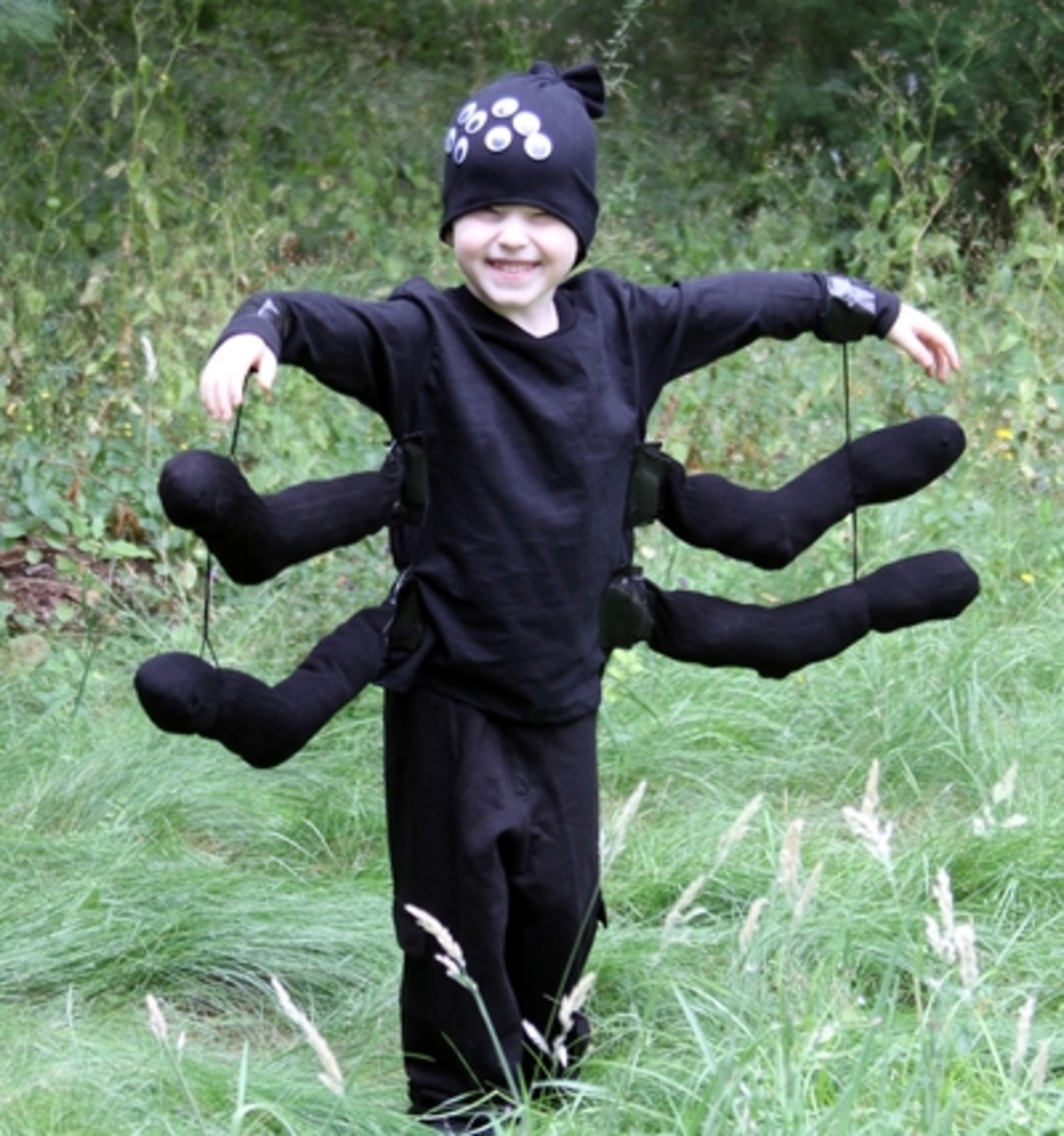 Spider using old black clothes and black socks.