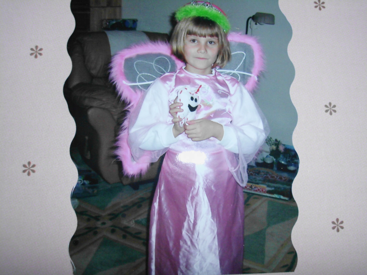 My daughter in 2005 as a toothfairy. I took items from different costumes to create it.