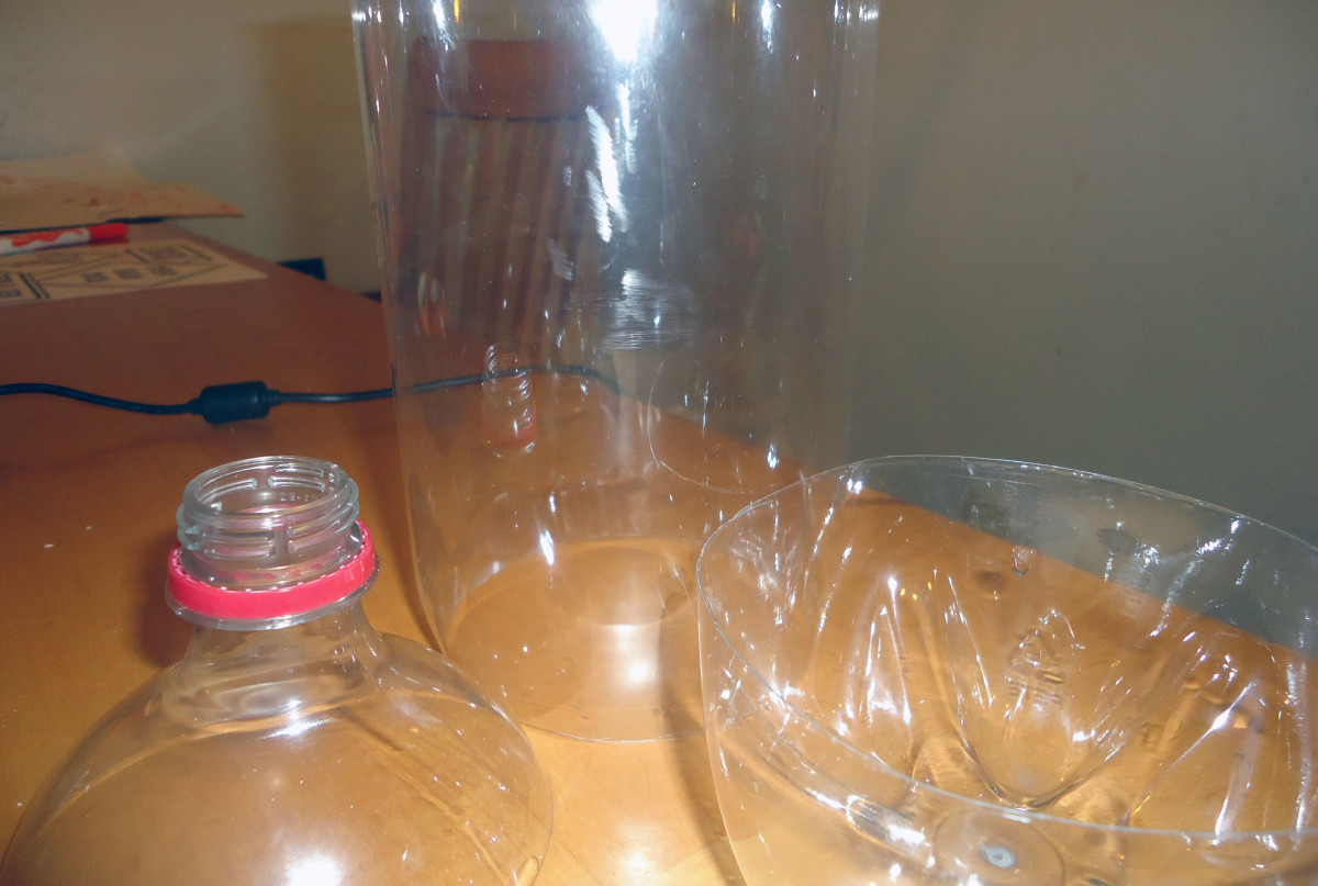 cut off top and bottom of 2 liter bottle
