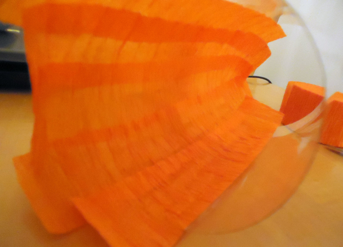 keep adhering sections of crepe paper around the inside