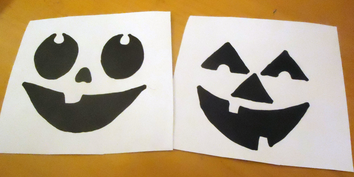 a couple of pumpkin templates printed from online and colored in with black paint marker