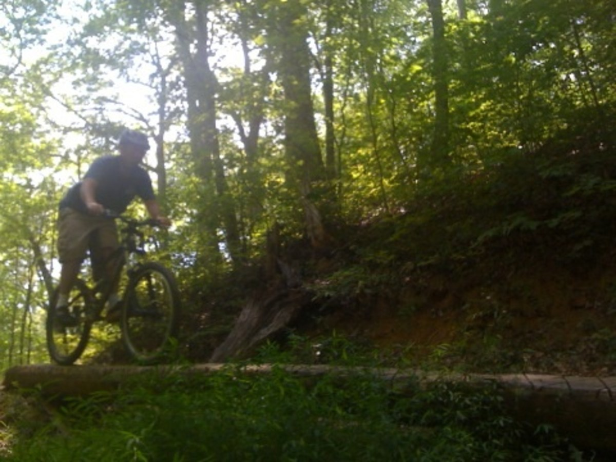This is me riding one of the log bridge trail features at Bent Creek. Bent Creek is my favorite mountain biking destination.