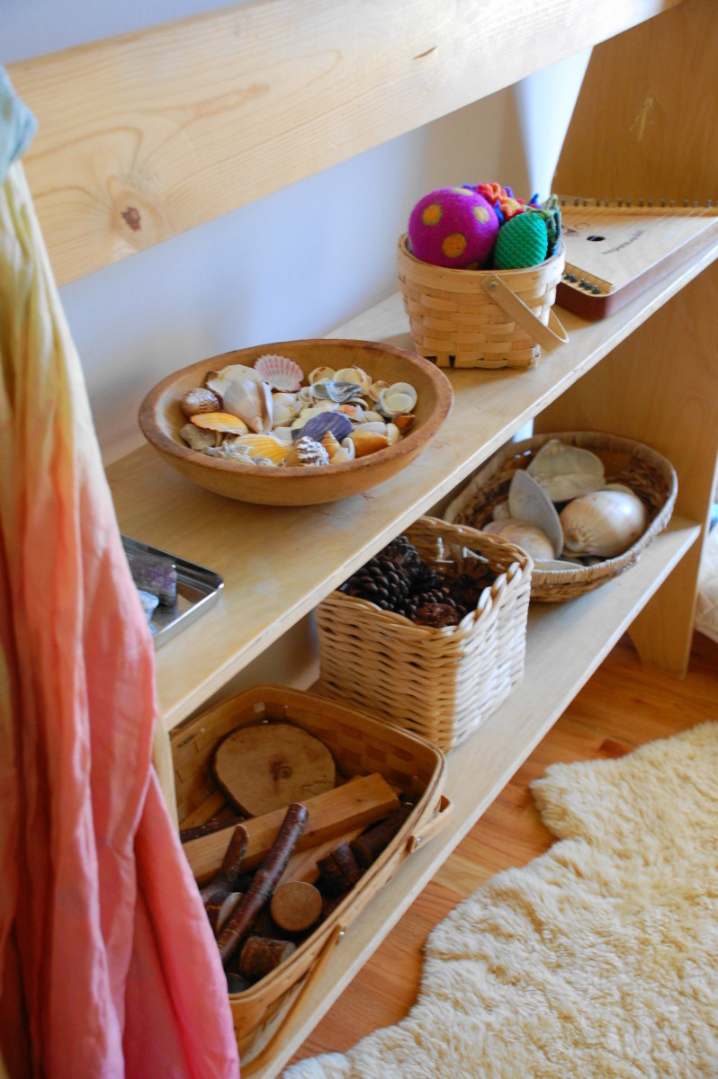 A nurturing Waldorf preschool classroom uses soft colors and natural materials.