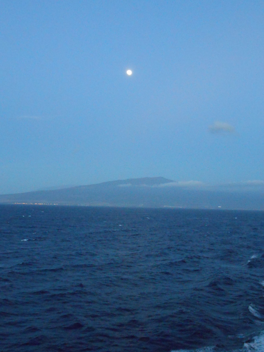 The moon over the island taken just after sunset leaving Kona  on the big island on the way to Kauai.