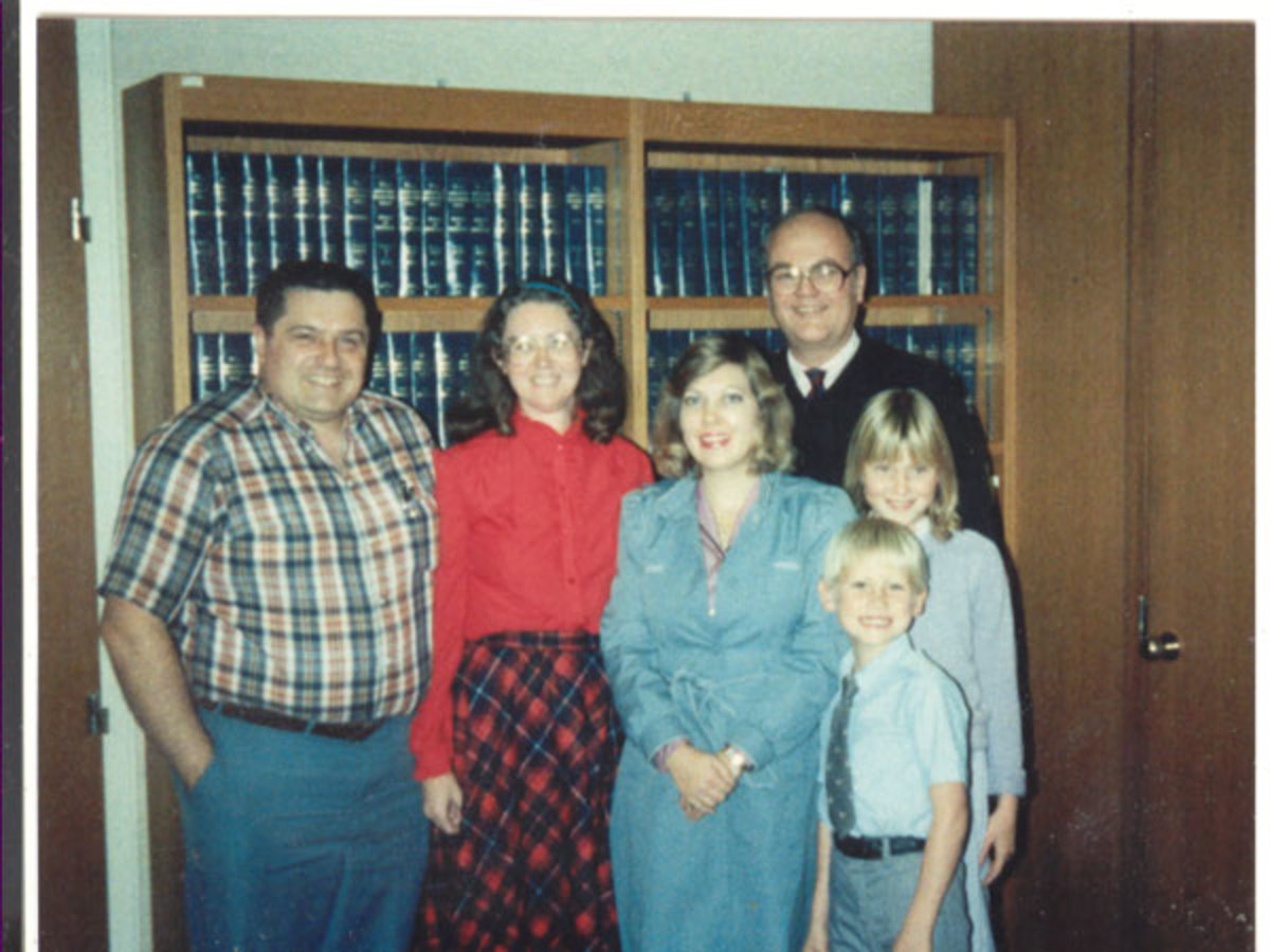 Adoption day family picture with judge and social worker coming between us and our children for the last time -- or so we thought that day.