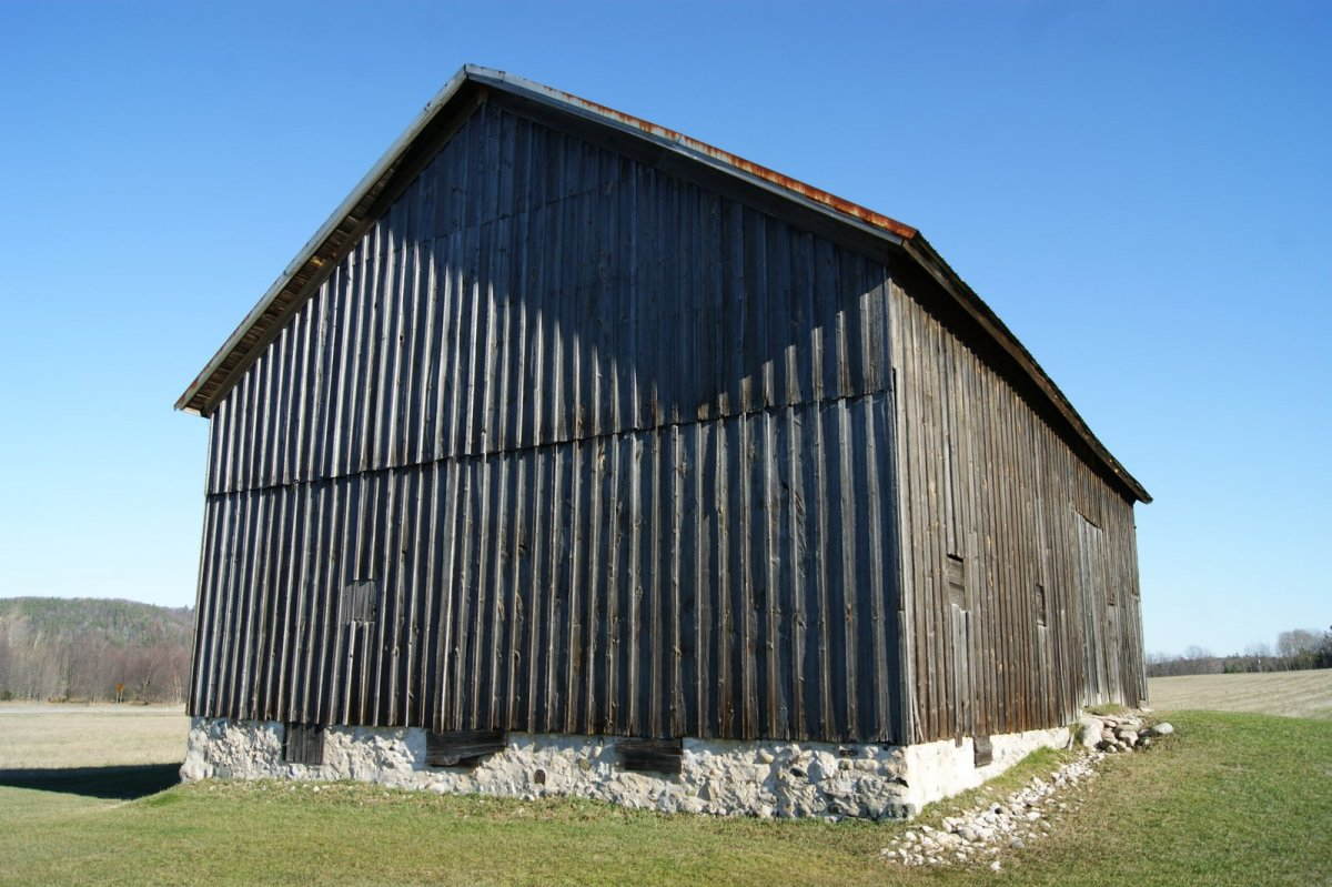 If the siding had been put on horizontally, rainwater would have collected on the edges of boards, causing them to rot.