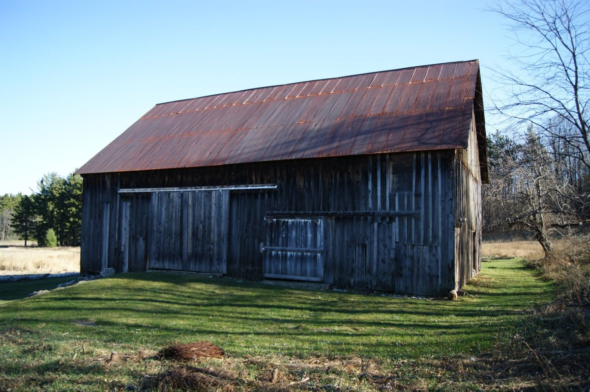 This barn does not have the raised stone foundation and ramp to a middle level, so it has two, rather than three stories.