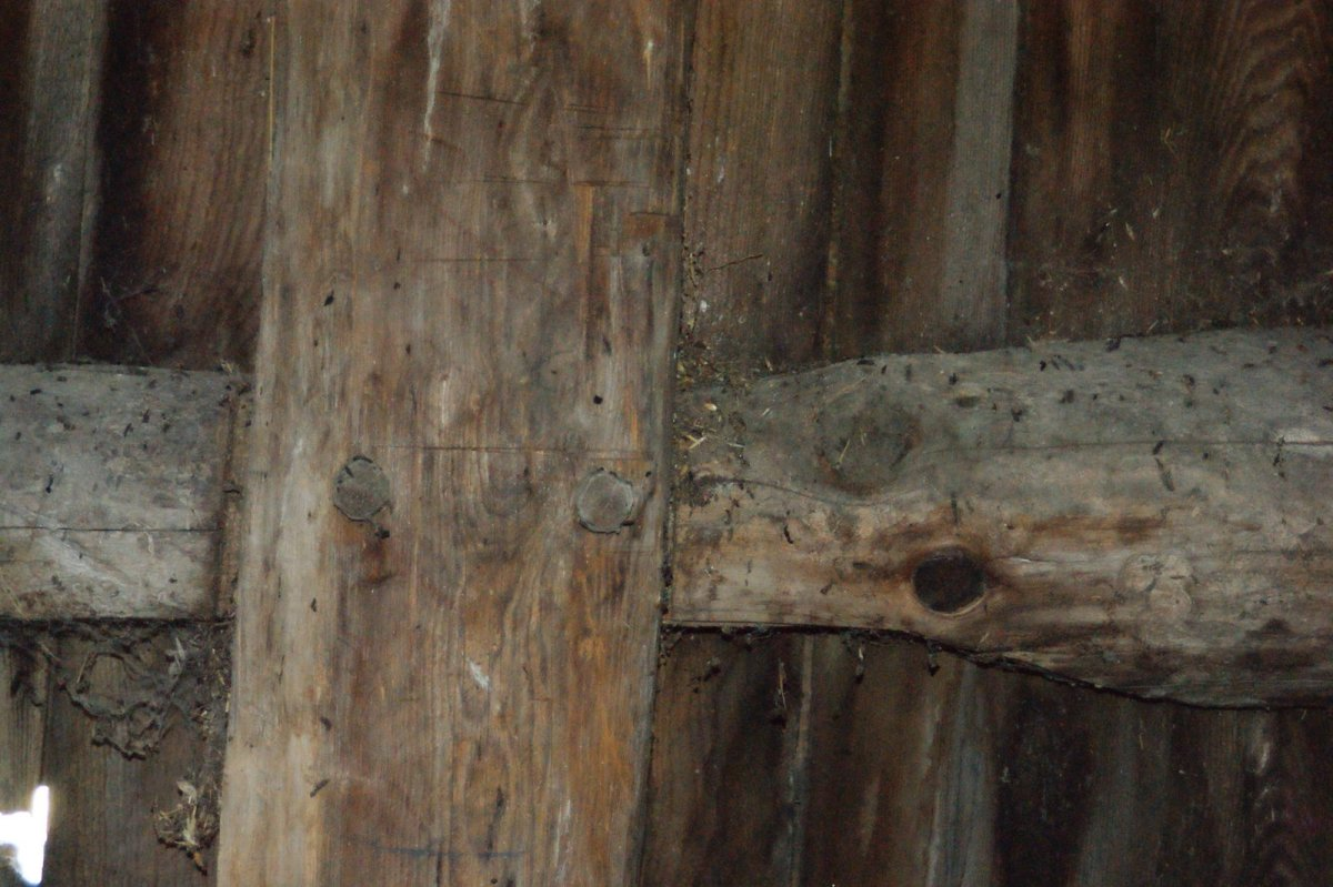 Hand hewn horizontal timbers held in place with wooden pegs.