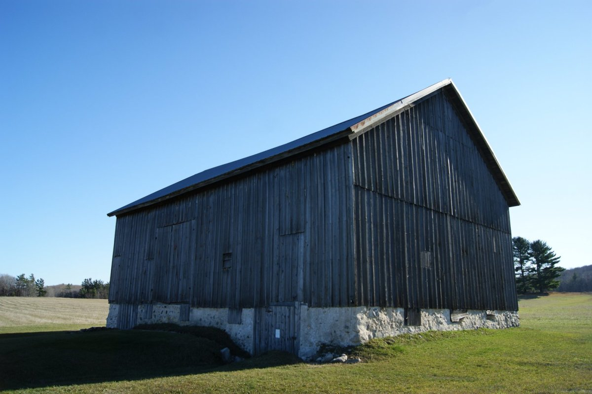 Barn siding was applied vertically rather than horizontally.  Small gaps between boards provided ventilation.