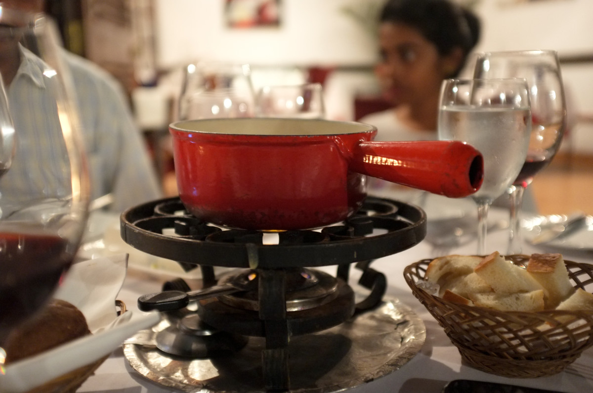 a fondue pot is ideal to use as a portable heat source for your air freshener. Substitute the pot with a dish or bowl that is heat resistant and put your infused water in it  and keep at a low heat after it has been boiled.