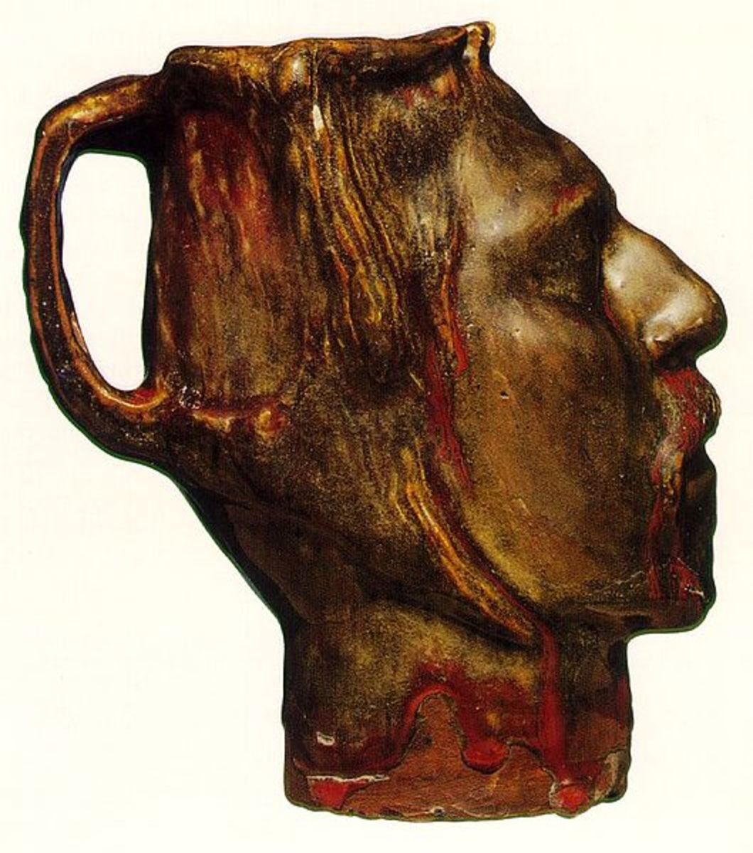 """Paul Gaugin's """"Jug In The Form Of A Head"""" is a classic example of a face mug."""