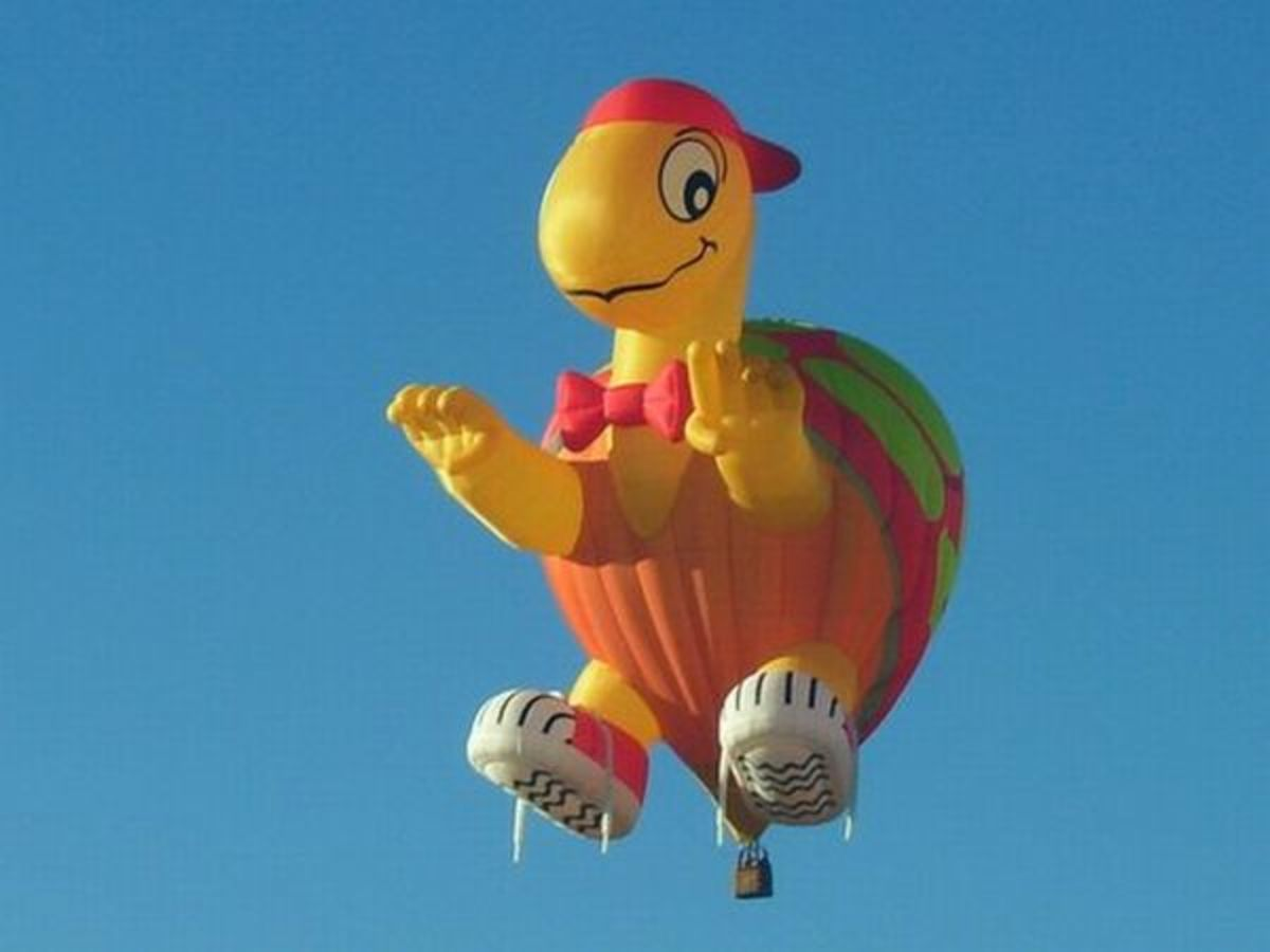 Happy Hot Air Balloon Turtle in Bright Orange and Yellow
