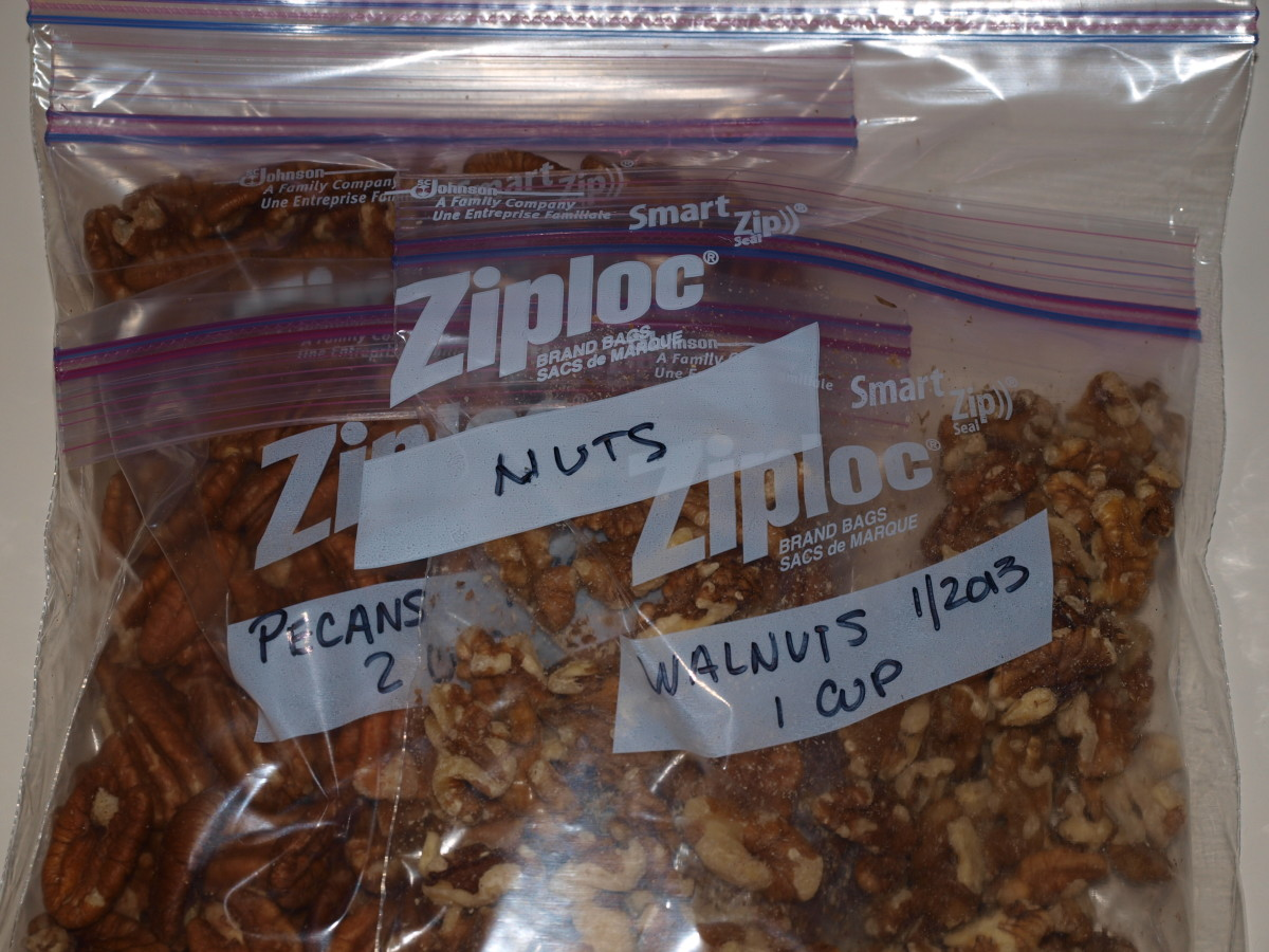 Small bags of nuts are placed inside a larger freezer bag for protection against food odors and dampness.