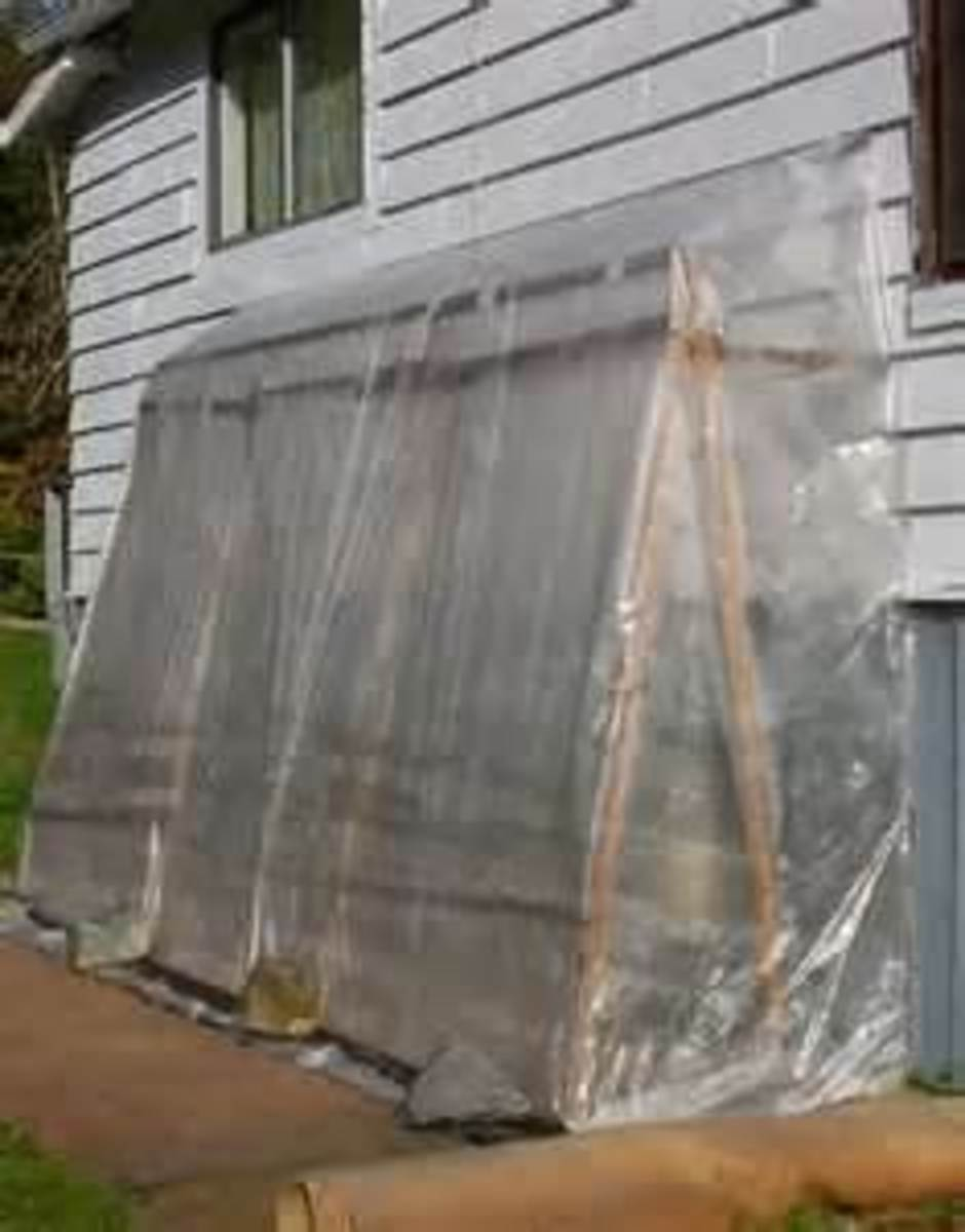 Framing and plastic against the house