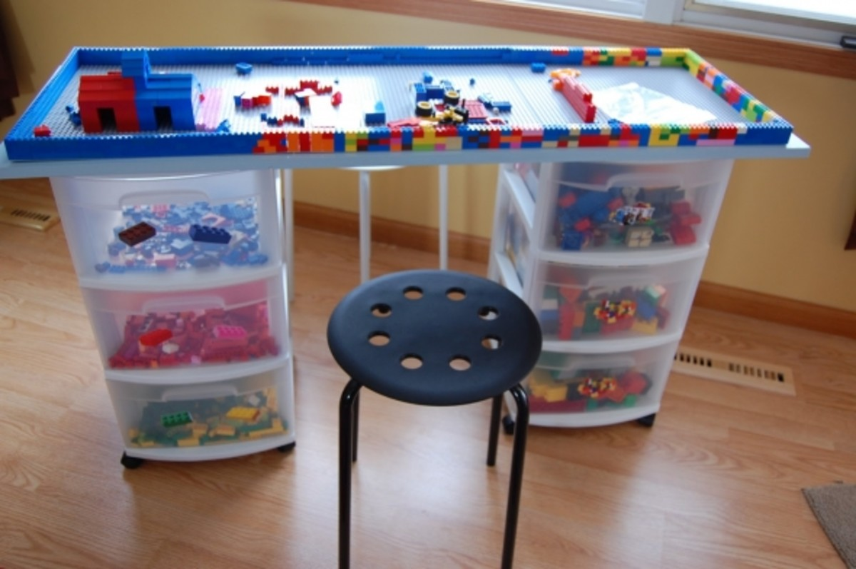 This DIY Lego Table created by www.ourweefamily.blogspot.com was made by placing a board on top of rolling storage bins which store all the Legos.