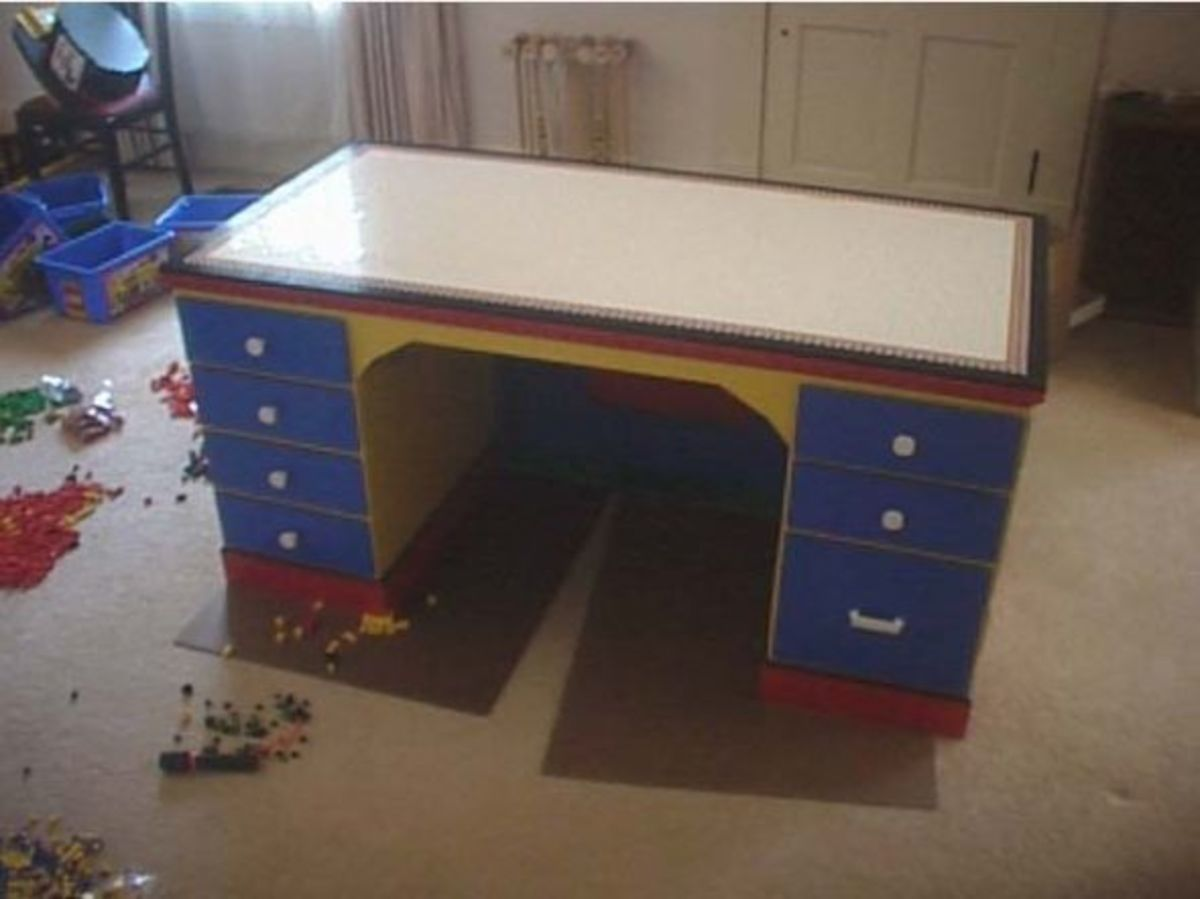 How about a DIY Lego Desk?? This was created by www.ericharshbarger.org who happens to be a big Lego builder himself. Again you can find lots of old desks at your local thrift stores and easily turn them into this.