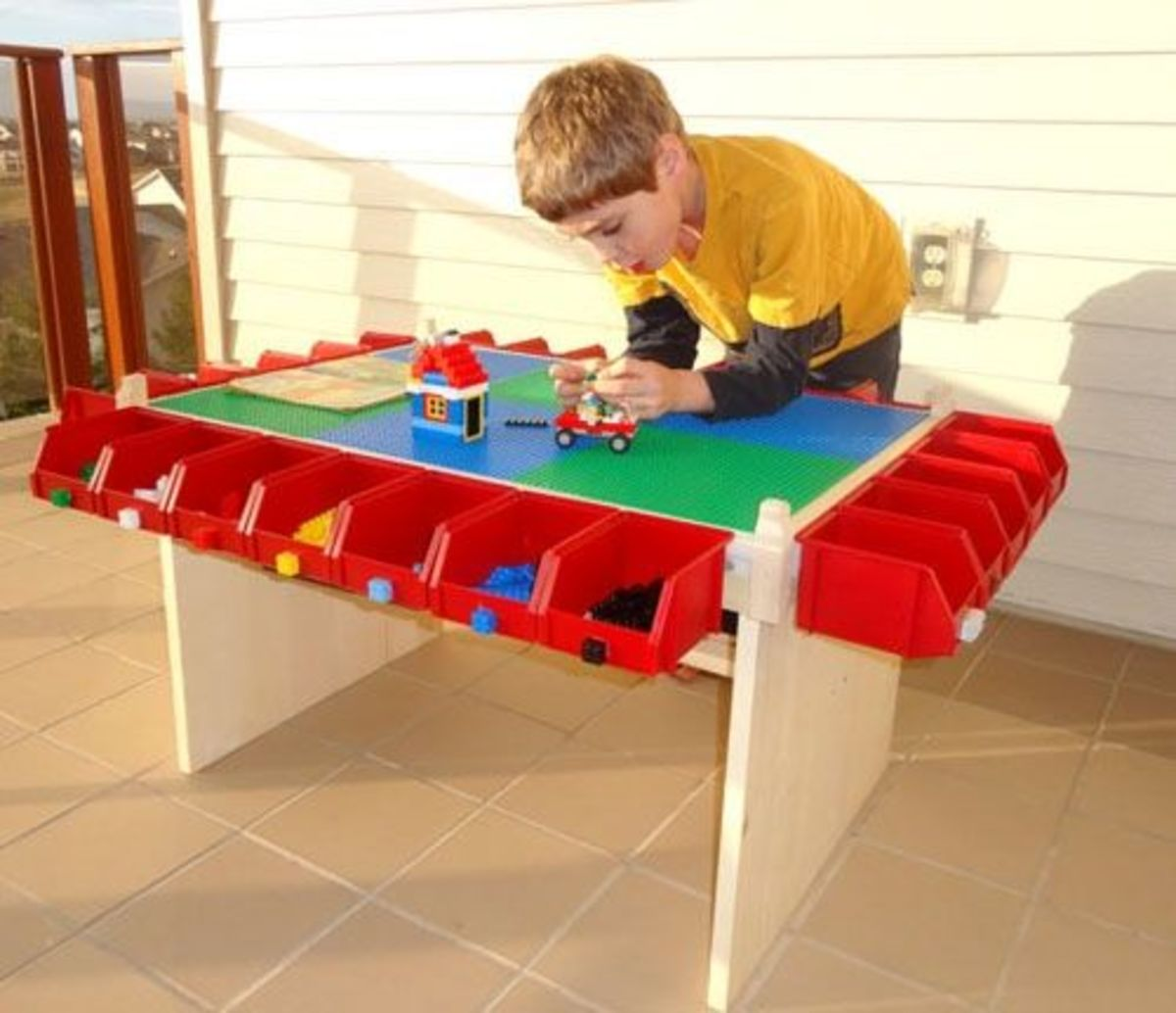 This DIY Lego Table was hand crafted and the bins added to all the sides to allow for EASY Lego Storage as well as sorting all the pieces.