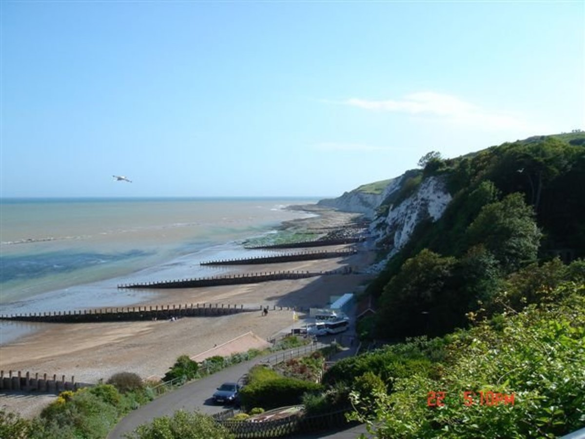 Holywell, Eastbourne: walking down the steep pathway from street-level to the lower promenade, far end of the western promenade.