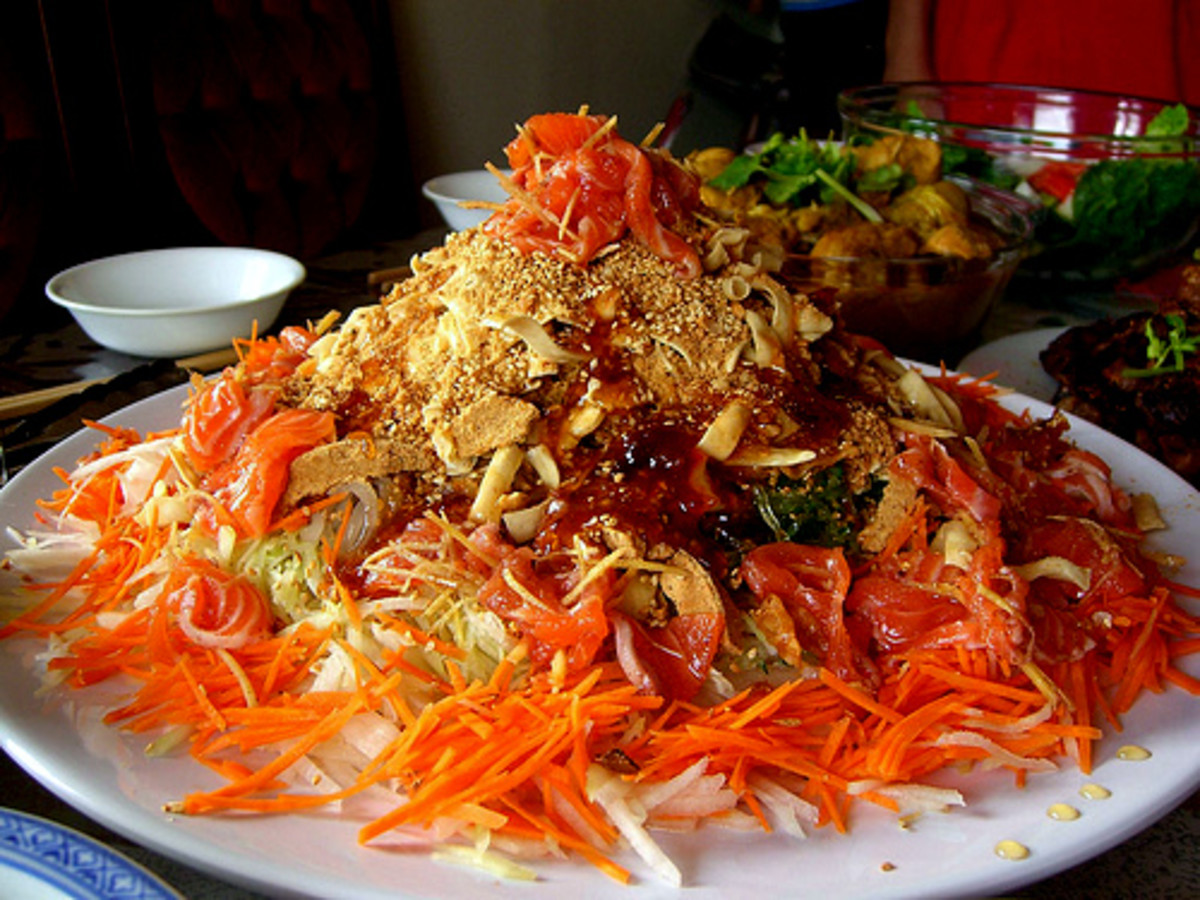 Yee sang or raw fish salad is traditionally eaten during Chinese New Year celebration in Malaysia and Singapore