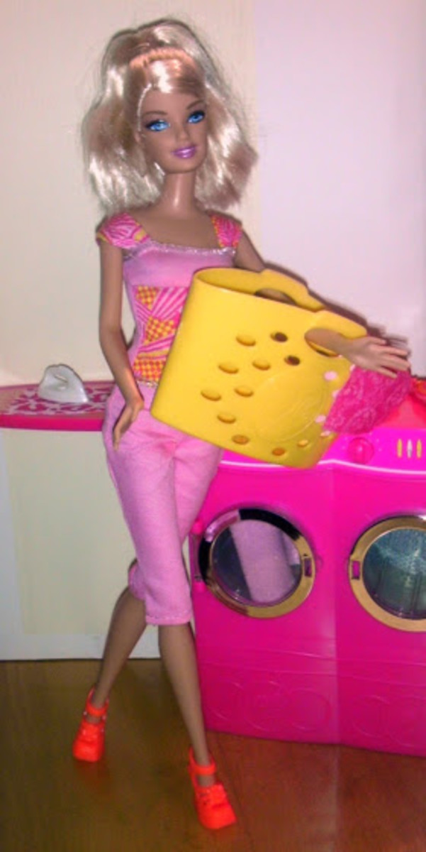 Barbie's laundry basket fits nicely on one arm.