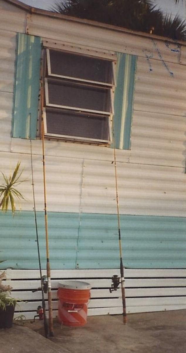 10' Bamboo rod with large Daiwa cast aluminum reel