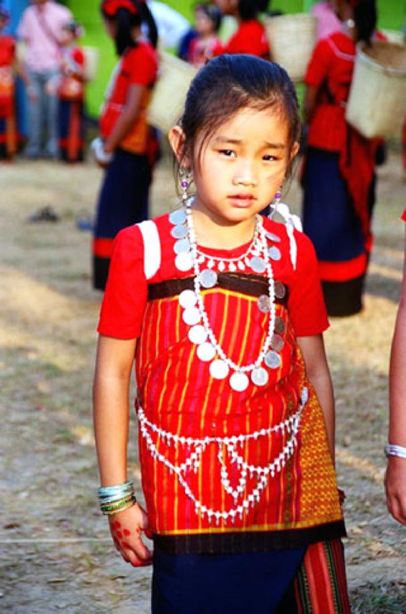 A Chakma girl wearing traditional dress