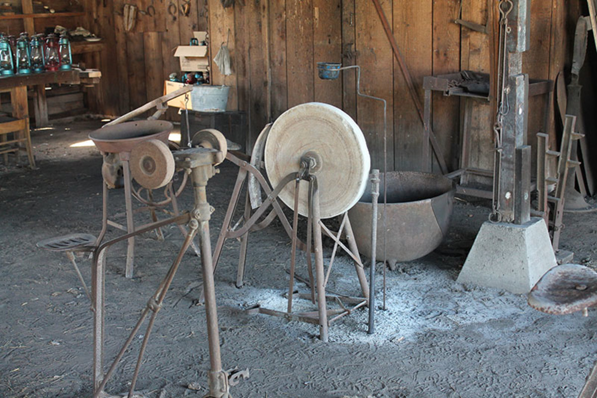 Human powered grinding wheel would be used to sharpen and form blades.