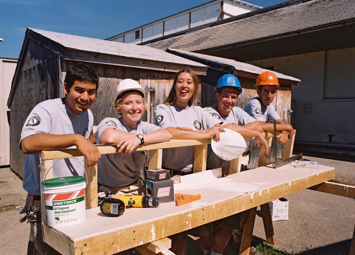 Teens volunteering...maybe this was on their bucket list?