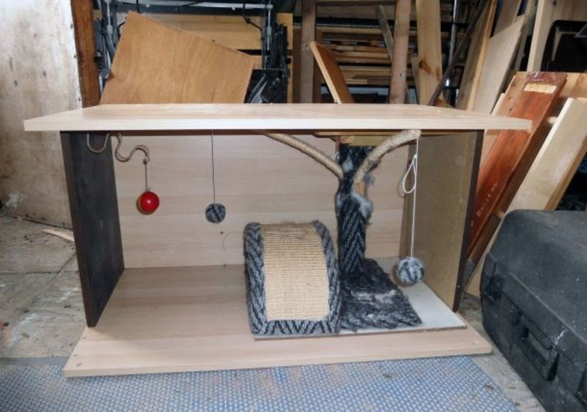 Cat cubbyhole and activity centre made from scrap wood and old cat scratching posts