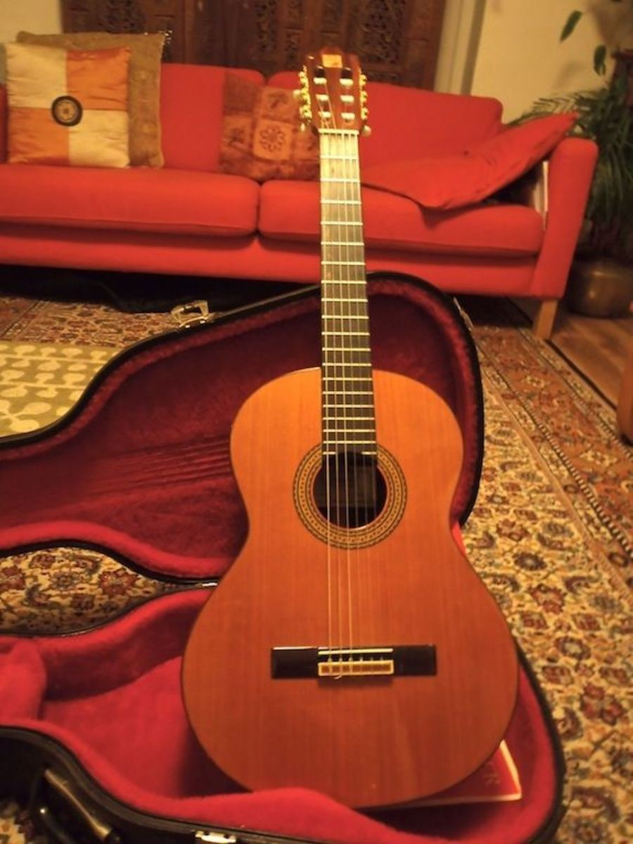 My guitar. An Alhambra Signorita P5. It has a solid red cedar top, gold plated machine heads and a mahogany neck.