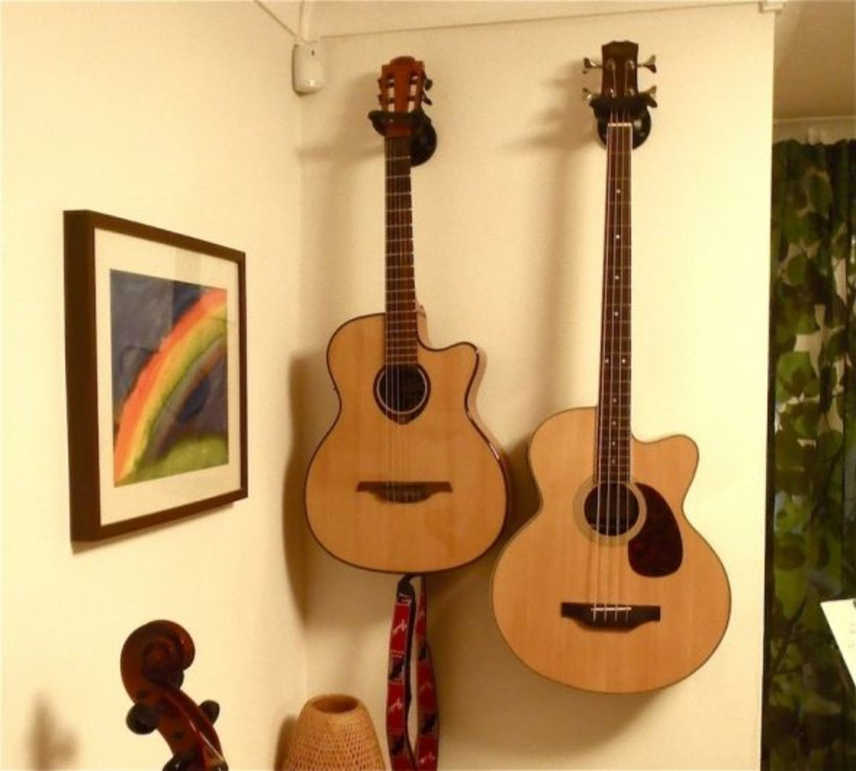 These are my son's latest guitars. A Lag acoustic - electric and a Brunswick Bass Guitar.